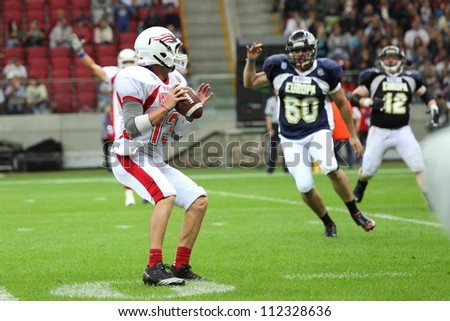 WARSAW, POLAND - SEPTEMBER 1: American football player, US team member Wes Carroll (QB) holds the football during Euro-American Challenge match on September 1, 2012 in Warsaw, Poland.