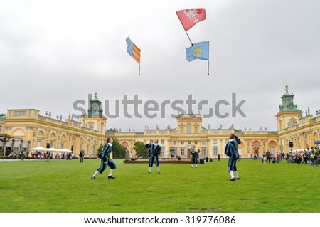 WARSAW, POLAND - SEPTEMBER 11, 2010: Brotherhood of the Knights Nowa Deba performs the art show of the juggling flags, during of the Wilanow Days event. - stock photo