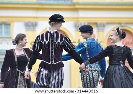 WARSAW, POLAND - SEPTEMBER 11, 2010: Ensemble Gratia Iuvenis shows the historical Court dances, during of the Wilanow Days event. - stock photo