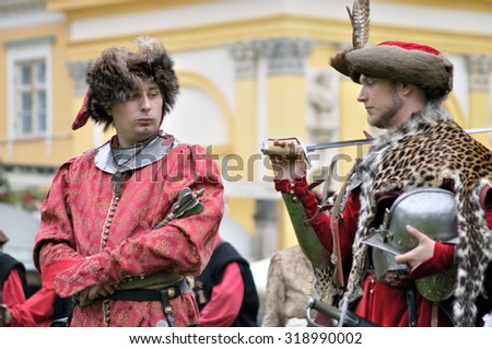 WARSAW, POLAND - SEPTEMBER 11, 2010: Presentation of the old-time nobility costumes, from the reign of King John III Sobieski, during of the Wilanow Days event. - stock photo
