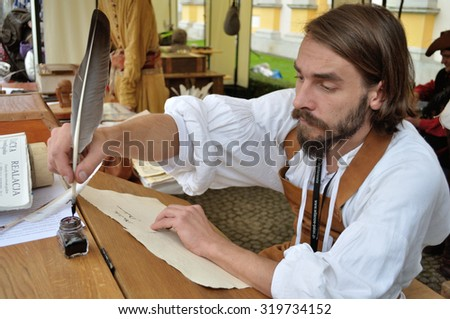 WARSAW, POLAND - SEPTEMBER 11, 2010 Royal Scribe shows the ancient art of calligraphy, during of the Wilanow Days event. - stock photo