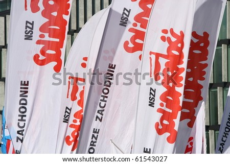 WARSAW, POLAND - SEPTEMBER 22: Solidarity flags during anti government trade unions demonstration on September 22, 2010 in Warsaw, Poland. - stock photo