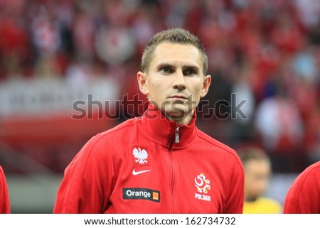 WARSAW - SEPTEMBER 6: Artur Jedrzejczyk (Poland) before the 2014 World Cup qualification match between Poland and Montenegro at the National Stadium on September 6, 2013 in Warsaw, Poland.  - stock photo