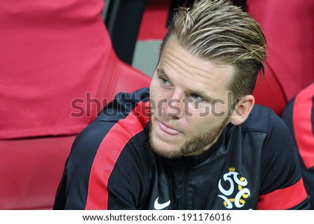 WARSAW - SEPTEMBER 6: Eugen Polanski (Poland) before the 2014 World Cup qualification match between Poland and Montenegro at the National Stadium on September 6, 2013 in Warsaw, Poland.  - stock photo