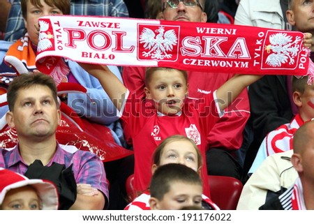 WARSAW - SEPTEMBER 6: Football fans of Poland during the 2014 World Cup qualification match between Poland and Montenegro at the National Stadium on September 6, 2013 in Warsaw, Poland.  - stock photo