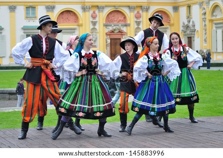 WARSAW - SEPTEMBER 11: Lowicz folk dance, performed by the ensemble Kuznia Artystyczna, during of the Wilanow Days event on September 11, 2010 in Warsaw, Poland. - stock photo
