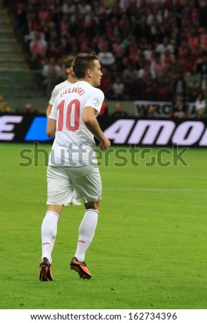 WARSAW - SEPTEMBER 6: Piotr Zielinski (Poland) during the 2014 World Cup qualification match between Poland and Montenegro at the National Stadium on September 6, 2013 in Warsaw, Poland.  - stock photo