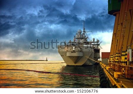 Warship in the port of dramatic scenery. - stock photo