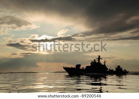 Warship with threatening sky - stock photo