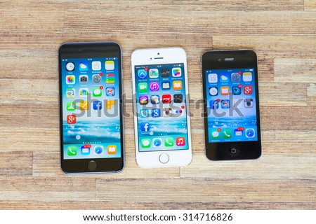 WARSZAWA, POLAND - MAY 13, 2015. Apple new Iphones 6, 5s and 4s on wooden table - stock photo