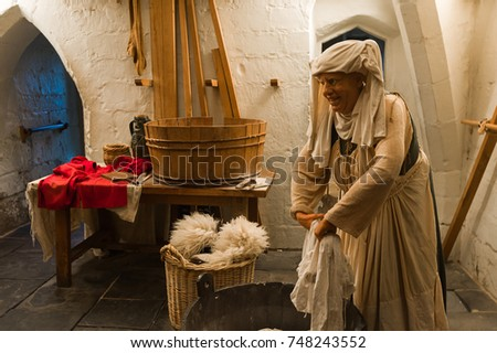 WARWICK CASTLE, WARWICKSHIRE, ENGLAND - SEPTEMBER 2016: Wax Figure at Warwick Castle showing medieval lifestyle.