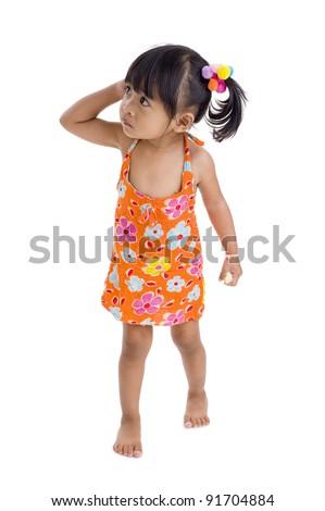 wary little girl walking over white - stock photo