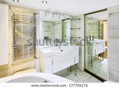 Wash stand with mirror in modern white bathroom interior - stock photo