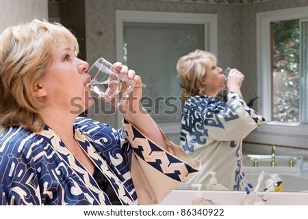 Wash the medicine down - stock photo