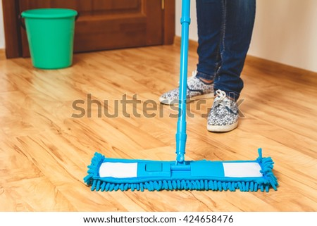 Wash wood floor mop. Housekeeping concept - stock photo