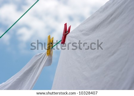 Washed clothes drying on a rope in the garden - stock photo