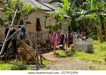 Washed clothes drying outside of an old rural house, Bali, Nusa penida, Indonesiahouse - stock photo