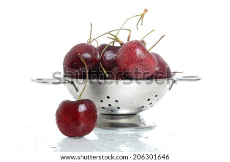 washed fresh cherries in a bowl isolated white background - stock photo