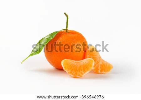washed tangerine with separated segments on white background - stock photo