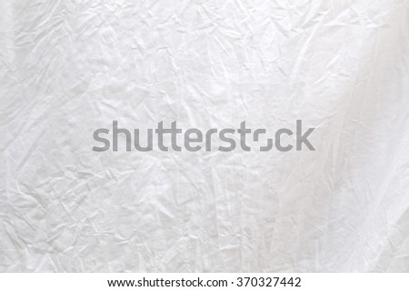 Washed white linen fabric piece ready to dry and iron - stock photo