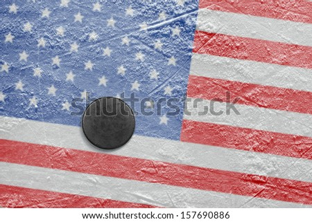 Washer and the image of the American flag on a hockey rink - stock photo
