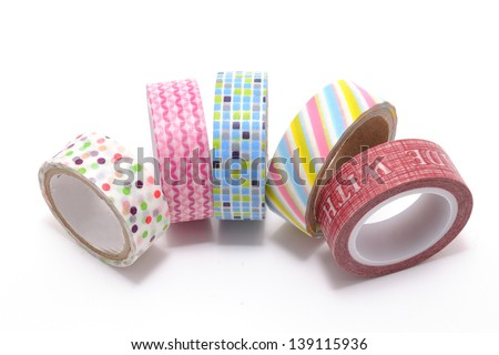 Washi Tape, a high quality masking tape made of rice paper, isolated on white background. Is beautiful yet useful at the same time. You can tear it, stick it, reposition it, or write on it. - stock photo