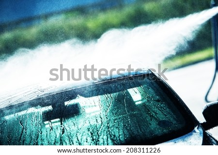 Washing Car in Hand Car Wash. Car Cleaning. - stock photo