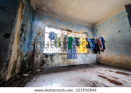 Washing day with laundry on clothesline in old apartment - stock photo