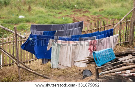 Washing day with laundry, Tribal's clothes line, Thailand - stock photo