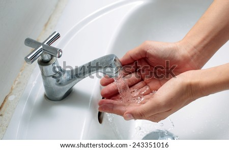 Washing Hands , Hygiene. Cleaning Hands. Washing hands under running water in a sink - stock photo