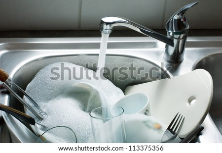Washing kitchen ware on sink stock photo 113375356 shutterstock - Lavish white and grey kitchen for hygienic and bright view ...