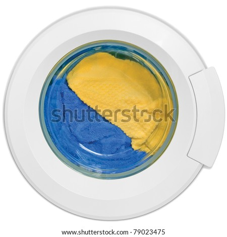 Washing machine door, clean colorful clothes, yellow, blue plush terry, isolated - stock photo