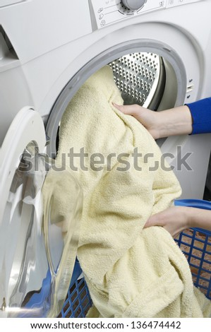 washing machine loaded with clothes