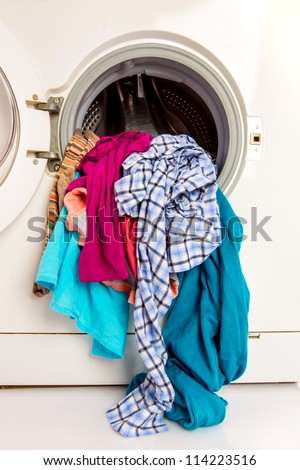 Washing machine with clean linen - stock photo