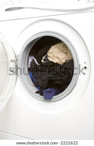Washing machine with door open and clothes inside after a wash