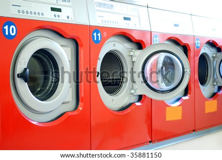 washing machines in a laundromat in a row - stock photo