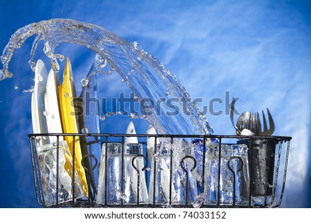 Washing plates in the dishwasher. Inside a dishwasher