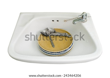 Washing The Dishes In The Kitchen - stock photo