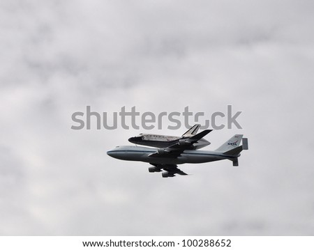 WASHINGTON APRIL 17: Shuttle Discovery Flies over the Capital on April 17, 2012 in Washington