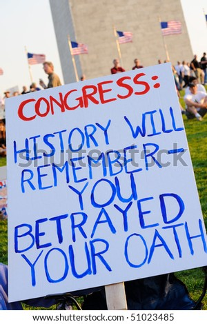 WASHINGTON - APRIL 15: Sign at the tax day tea party rally at the Washington monument on April 15, 2010 in Washington, D.C. - stock photo