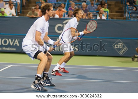 WASHINGTON -AUGUST 3:  Andy Murray (GBR) and doubles partner Daniel Nestor (CAN) during first round doubles play at the Citi Open tennis tournament on August 3, 2015 in Washington DC.    - stock photo