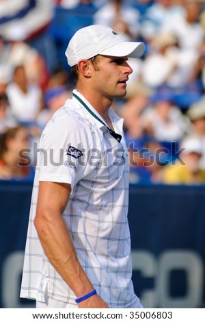 WASHINGTON - AUGUST 9: Andy Roddick (USA) takes a breather in the championship match of the Legg Mason Tennis Classic August 9, 2009 in Washington. Roddick was defeated by Juan Martin Del Potro (ARG). - stock photo