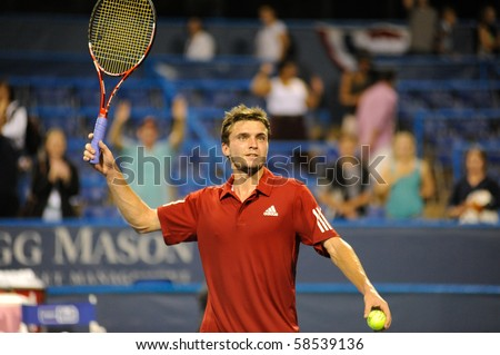 WASHINGTON - AUGUST 5: Gilles Simon (FRA) after eliminating Andy Roddick (USA, not pictured) from the Legg Mason Tennis Classic on August 5, 2010 in Washington. - stock photo