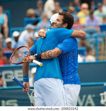 WASHINGTON AUGUST 3: Jean-Julien Rojer (NED) and Horia Tecau (ROU) after winning the doubles final title at Citi Open tennis tournament on August 3, 2014 in Washington DC - stock photo