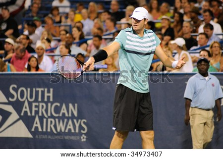 WASHINGTON - AUGUST 8: John Isner (USA) gestures at the Legg Mason Tennis Classic semifinals on August 8, 2009 in Washington. Isner was defeated by Andy Roddick (USA).
