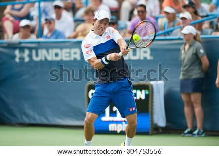 WASHINGTON  AUGUST 9: Kei Nishikori (JPN) defeats John Isner (USA, not pictured) to take the mens title at the Citi Open tennis tournament on August 9, 2015 in Washington DC  - stock photo
