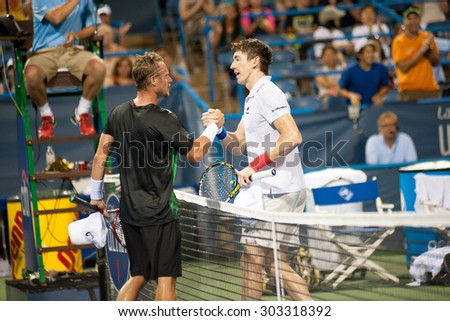 WASHINGTON - AUGUST 4:  Lleyton Hewitt (AUS) and John-Patrick Smith (AUS) after Hewitt's win at the Citi Open tennis tournament on August 4, 2015 in Washington DC  - stock photo