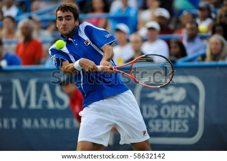 WASHINGTON - AUGUST 7: Marin Cilic (CRO) is defeated by David Nalbandian (ARG, not pictured) in the semifinals of the Legg Mason Tennis Classic on August 7, 2010 in Washington. - stock photo