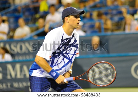 WASHINGTON - AUGUST 4: Mike Bryan (USA) in early doubles action at the Legg Mason Tennis Classic on August 4, 2010 in Washington. Bob and Mike Bryan defeated Andrew Courtney and Michael Shabaz (USA). - stock photo