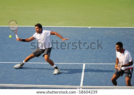 WASHINGTON - AUGUST 6: Rohan Bopanna (IND) and Aisam-Ul-Haq Qureshi (PAK) defeat Bob and Mike Bryan (USA) at the Legg Mason Tennis Classic on August 6, 2010 in Washington. - stock photo